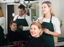 Hairdressing saloon. Woman hairdresser cuts women at the hairdresser saloon stock photo