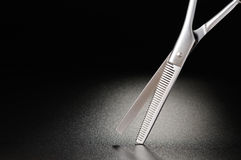 Hairdressing scissors. Professional hairdressing scissors on a black matt background Royalty Free Stock Photography