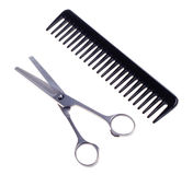 Hairdressing scissors and comb Royalty Free Stock Photography