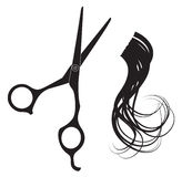 Hairdressing scissors and a lock of curly hair Stock Image