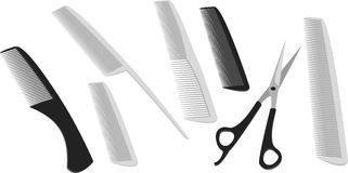 Hairdressing scissors and a many comb Royalty Free Stock Photo