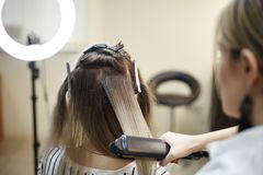 Hairdressing services. Hair styling process in a beauty salon royalty free stock photography