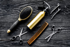 Hairdressing tools on grey wooden background top view Stock Photos