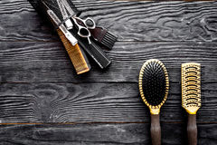 Hairdressing tools on grey wooden background top view space for text Stock Images