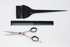 Hairdressing tools, metal scissors stainless steel, plastic comb Royalty Free Stock Images