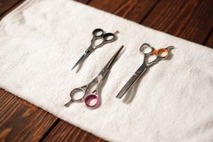 Hairdressing tools on a towel - scissors, combs, clipper. Hairdressing tools on a towel - scissors, combs, clipper royalty free stock image