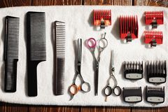 Hairdressing tools on a towel - scissors, combs, clipper. royalty free stock images