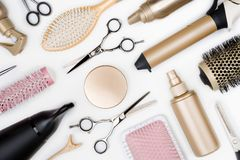 Hairdressing tools and various hairbrushes on white background top view.  Stock Photos