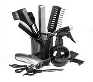 Hairdressing tools on white stock photography