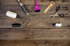 Hairdressing tools on wooden background Royalty Free Stock Images