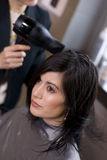 Woman Receives Hairdry at Professional Salon Royalty Free Stock Image