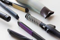 Hairdryer, denominação quente e ferros de ondulação fotografia de stock royalty free