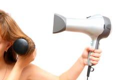 Hairdryer fêmea da terra arrendada da mão Foto de Stock