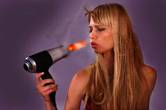 Hairdryer fire woman Stock Photography
