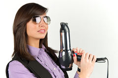 Hairdryer gun holding by a woman Royalty Free Stock Photo