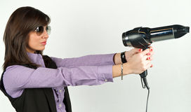 Hairdryer gun holding by a woman Royalty Free Stock Photos