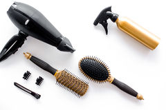 Hairdryer and hairdresser tools in beauty salon on white background top view copyspace Stock Image