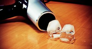 Hairdryer Vs Ice cubes Royalty Free Stock Photo
