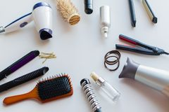 Hairdryers, irons, hot styling sprays and brushes royalty free stock photos