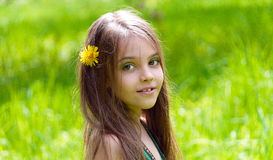 Haired girl in a spring park. Stock Photos