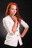 haired röd dräkt för härlig flicka Royaltyfria Foton