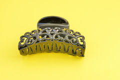 Hairgrip. This hair clip is photographed on a yellow background Stock Photography