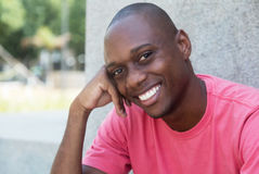 Hairless african american man laughing at camera stock photo