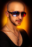 Hairless male in sunglasses looking at camera Stock Image