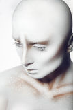 Hairless pretty woman with white paint on body and face Stock Images