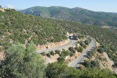 Hairpin Bend Mountain Road In Greece. Hairpin bend road mountain crosses Peloponnese Region in Greece royalty free stock photography