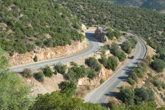 Hairpin Bend Mountain Road In Greece. Hairpin bend road mountain crosses Peloponnese Region in Greece royalty free stock image