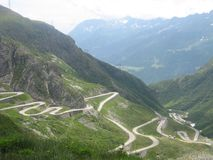 Hairpin bends high up in the mountains. A picture of hairpin bends high up in the mountains in Switserland taken during a cartrip on vacation during summer with Stock Photography
