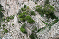 Hairpin bends, Italy. Looking down at sharp hairpin bends in a road cut into the steep mountain landscape, Italy royalty free stock photo