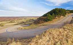 Hairpin corner in a countryside road Royalty Free Stock Images