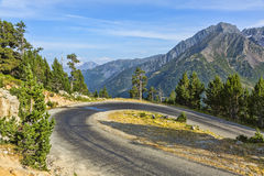Hairpin Curve on a Scenic Road. Located in the Neouvielle Massif in Pyrenees Mountains in France stock images