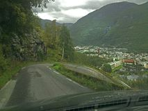 Hairpin curve on a steep road photographed from inside a car through the front window. royalty free stock photos