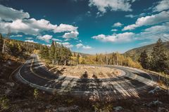Hairpin turn at autumn in Colorado, USA. Highway with hairpin turn switchback at autumn sunny day in Rocky Mountain National Park. Colorado, USA royalty free stock photos