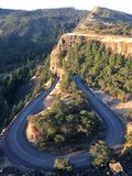 Hairpin turn. Curve in roadway among trees and scenery royalty free stock image