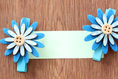 Hairpins of blue flower pattern and note paper. Royalty Free Stock Photos