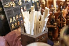 Hairpins carved from ivory at a market booth stock image