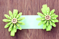 Hairpins of green flower pattern and note paper. Royalty Free Stock Photography