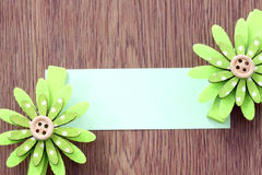 Hairpins of green flower pattern and note paper. Royalty Free Stock Photo