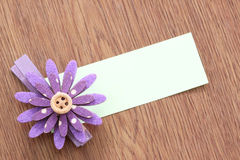 Hairpins of purple flower and note paper. Stock Photo