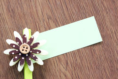 Hairpins of purple flower and note paper. Royalty Free Stock Images