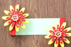 Hairpins of red mix yellow pattern and note paper. Royalty Free Stock Photography