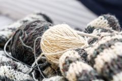 Hairs of wool, knitting needles and woolen clothes are prepared for work. Close-up royalty free stock photos