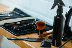 Hairsdresser devices lying on the table Royalty Free Stock Image