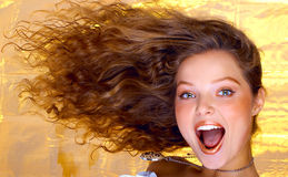 Hairstyle. Pretty girl with great fly-away hair Stock Photography