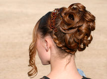 Hairstyle. Young woman and her beautiful hairstyle for ceremony Stock Photos