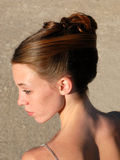 Hairstyle. Young woman and her beautiful hairstyle for ceremony Stock Photo